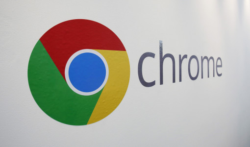 The Chrome logo is displayed at a Google event, Tuesday, Oct. 8, 2013 in New York. Google is introducing a $279 laptop that runs its Internet-centric Chrome operating system, borrowing many of the high-end features found in models that cost $1,000 or more. (AP Photo/Mark Lennihan)